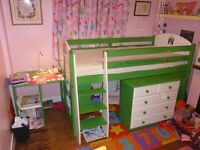 Mid sleeper cabin bed with desk and multiple shelving units/cupboard