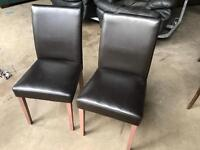 2 brown leather chairs