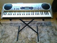 Electric Casio Keyboard with Stand