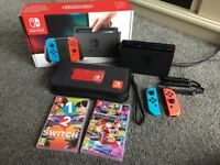 Nintendo Switch Console Neon, Mario Kart 8 Deluxe & 1-2 Switch Game & Case - Used Twice