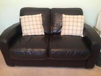 2 leather look two seater sofas