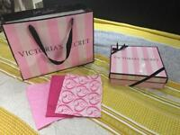 Victoria Secret gift box and bag with paper .
