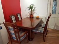 Wooden Dining Table (extendable) & 7 chairs (inc 1 carver). Hard wood. Walnut?