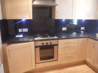 Modern unfurnished 2 bed ground floor flat in central location.