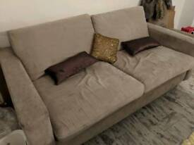 Light brown two seater sofa