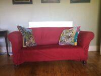 2 Seater sweet red velvet sofa.