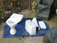 Wash basin with pedestal and toilet with cistern