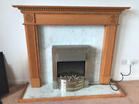 Carved solid wood fireplace with electric fire