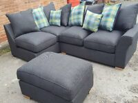 Very nice Brand New grey corner sofa and footstool.or larger corner.can deliver