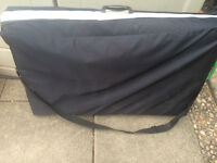 Portable Massage table in excellent condition size 73 x 24 with carry cover and towelling cover.