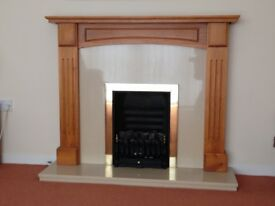 A SOLID WAXED PINE FIREPLACE SURROUND
