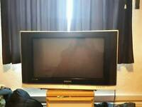 wide screen Samsung tv with hd free view box