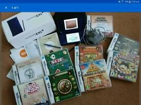 Nintendo DSi met. Dk Blue....9 games, case and charger..vgc