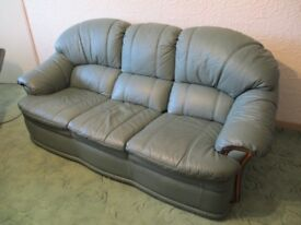 Green leather 3-seat sofa and two armchairs