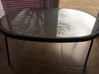 Glass top ratten table