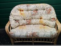 2 Seat Wicker Sofa and additional two chairs.
