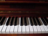 upright small piano by b squire