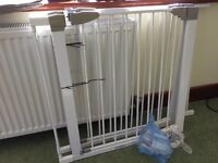 Two Lindam self-closing stair gates with three extensions