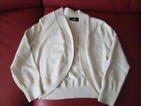 THIS IS A BEIGE YOUNG LADIES BOLERO SIZE SMALL