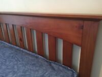 NEW double bed new mattress and wooden headboard