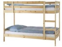 Wooden bunk bed with mattresses