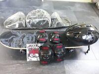 Skateboard, helmet, knee and elbow pads