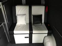 3/4 rock and roll bed with metal frame and seatbelts.