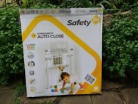 Two Safety First Pressure Baby Gates and One Extender Piece