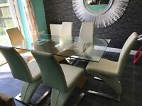 Glass table and leather chairs very Heavy
