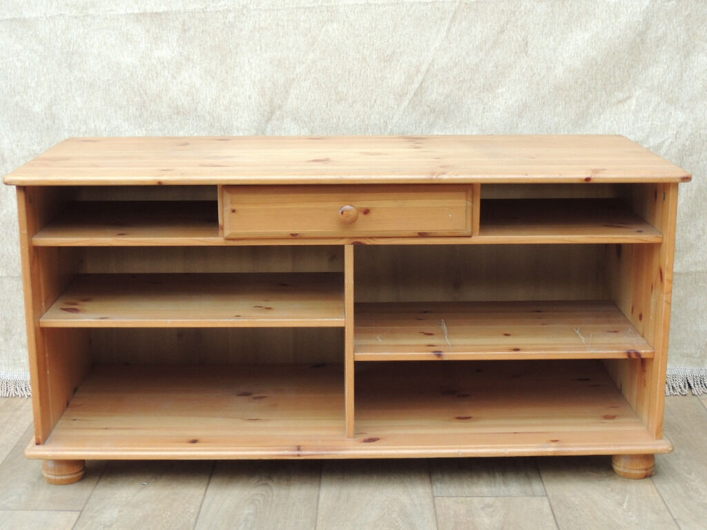 Cheap pine tv unit (Deliveryin Eltham, LondonGumtree - Pine tv unit (Size 116cm W; 47cm D; 58cm H); Solid wood tv unit with multiple shelves; Ideal for storage as well as tv placement; Strong; 2 Adjustable shelves; The rest are fixed; 1 middle drawer; Bun feet; Traditional lacquered pine finish;...