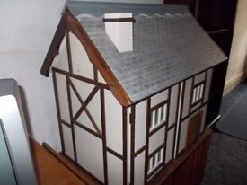 Large Dolls House with removable roof, ground and first floor consisting of four separate rooms