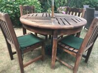 A excellent condition solid teak garden table and chairs, and bench