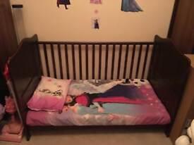 Dark wooden cot bed