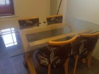 Glass topped Dining Table with 4 chairs