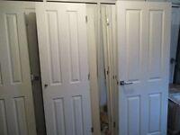 12x white 4 panel grained doors.