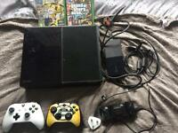 Xbox One including two controllers, a rechargeable battery pack, two games and a Microsoft Account