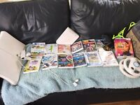 Complete Wii console, balance board and numerous games