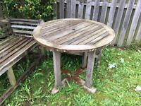 Round teak garden table