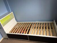 Ikea bed and storage headboard