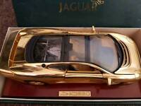 Gold plated e type jaguar.