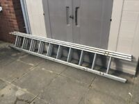 Three section extendable aluminium ladder with stand off.