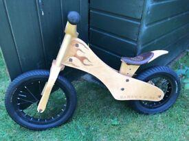Children's first wooden balance bike