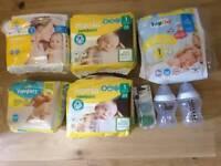 Newborn baby nappies, bottles and dummies (new)
