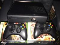 Xbox 360 slim edition 300 gig boxed with 36 games with Xbox connect