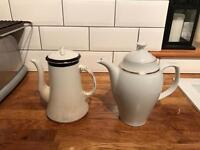 Two China teapots and plates