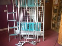 Metal bunk beds, bottom bed is a small double that can convert into a sofa and the top is a single