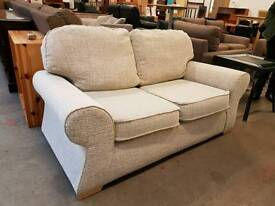 Cream fabric two seater sofa in excellent condition