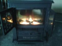 Cast iron Electric log effect fire in ex condition