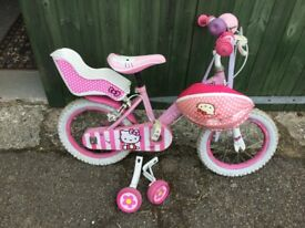 Girls hello kitty bike with stabilisers and basket