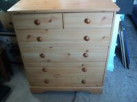 a large wheeled chest of drawers in good condition.